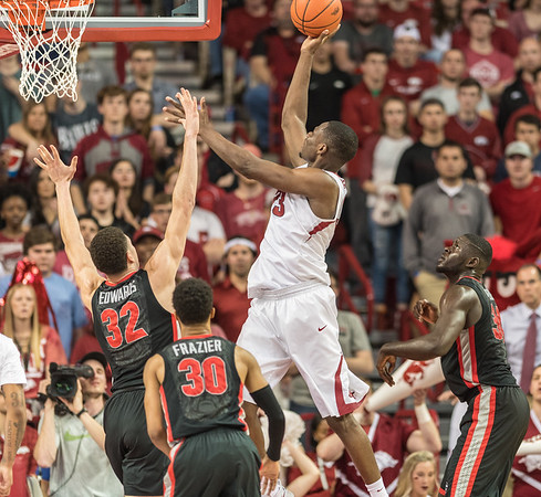 Arkansas Razorbacks forward Moses Kingsley (33) shoots over Georgia Bulldogs forward Mike Edwards (32) during a basketball game between Arkansas and Georgia on Saturday, 3/4/2017.  (Alan Jamison, Nate Allen Sports Service)