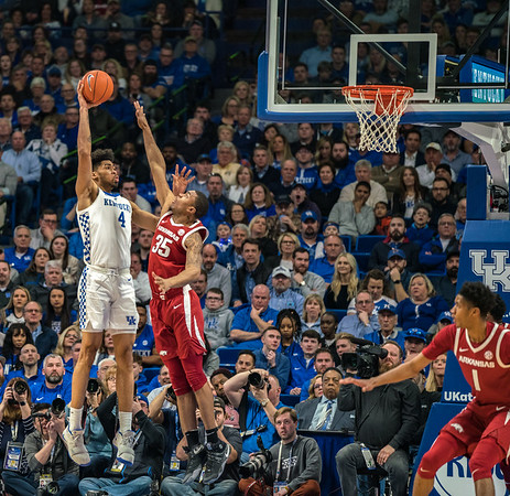 Arkansas Razorbacks forward Reggie Chaney (35) defends against Kentucky Wildcats forward Nick Richards (4) during a basketball game between the Arkansas Razorbacks and the Kentucky Wildcats on Tuesday, January 26, 2019, at Rupp Arena.  (Alan Jamison, Nate Allen Sports Service)