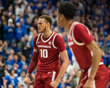 Arkansas Razorbacks forward Daniel Gafford (10) reacts to a mugging during a basketball game between the Arkansas Razorbacks and the Kentucky Wildcats on Tuesday, January 26, 2019, at Rupp Arena.  (Alan Jamison, Nate Allen Sports Service)