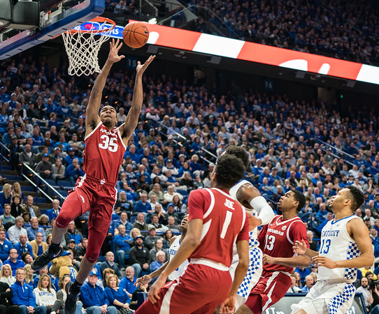 Arkansas Razorbacks forward Reggie Chaney (35) with an alley-oop dunk during a basketball game between the Arkansas Razorbacks and the Kentucky Wildcats on Tuesday, January 26, 2019, at Rupp Arena.  (Alan Jamison, Nate Allen Sports Service)