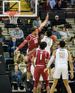Arkansas Razorbacks forward Daniel Gafford (10) defends  during a basketball game between the Arkansas Razorbacks and the Vanderbilt Commodores on Wednesday, March 6, 2019, at Memorial Gymnasium.  (Alan Jamison, Nate Allen Sports Service)