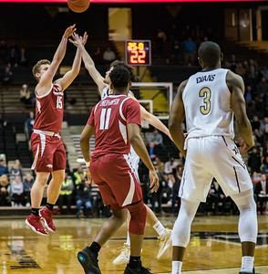 Arkansas Razorbacks guard Jonathan Holmes (15) shoots a three pointer during a basketball game between the Arkansas Razorbacks and the Vanderbilt Commodores on Wednesday, March 6, 2019, at Memorial Gymnasium.  (Alan Jamison, Nate Allen Sports Service)