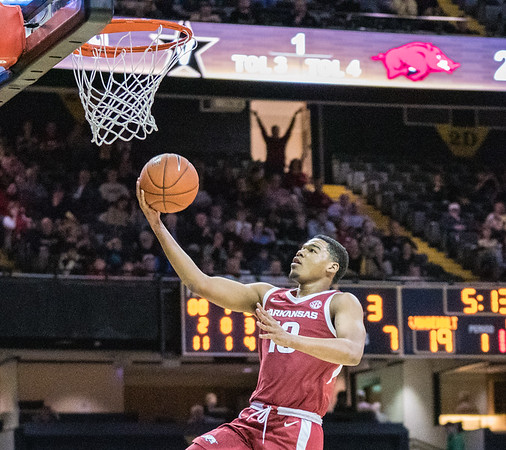 Arkansas Razorbacks guard Mason Jones (13) with a layup  during a basketball game between the Arkansas Razorbacks and the Vanderbilt Commodores on Wednesday, March 6, 2019, at Memorial Gymnasium.  (Alan Jamison, Nate Allen Sports Service)