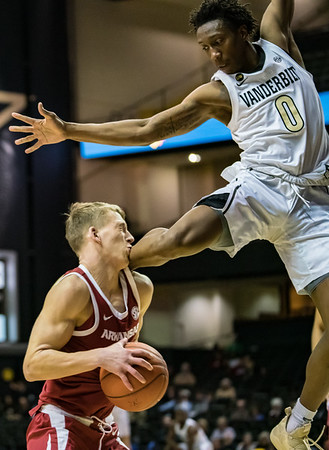 Arkansas Razorbacks guard Ty Stevens (12) is fouled by Vanderbilt Commodores guard Saben Lee (0) during a basketball game between the Arkansas Razorbacks and the Vanderbilt Commodores on Wednesday, March 6, 2019, at Memorial Gymnasium.  (Alan Jamison, Nate Allen Sports Service)