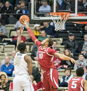 Arkansas Razorbacks forward Daniel Gafford (10) blocks a shot during a basketball game between the Arkansas Razorbacks and the Vanderbilt Commodores on Wednesday, March 6, 2019, at Memorial Gymnasium.  (Alan Jamison, Nate Allen Sports Service)