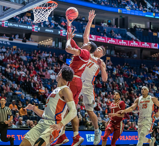 Arkansas Razorbacks guard Mason Jones (13) goes up for a layup during an SEC Tournament basketball game between the Arkansas Razorbacks and the Florida Gators on Thursday, March 14, 2019, at Bridgestone Arena.  (Alan Jamison, Nate Allen Sports Service)