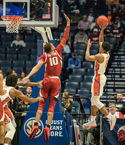 Florida Gators guard KeVaughn Allen (5) shoots over  Arkansas Razorbacks forward Daniel Gafford (10) during an SEC Tournament basketball game between the Arkansas Razorbacks and the Florida Gators on Thursday, March 14, 2019, at Bridgestone Arena.  (Alan Jamison, Nate Allen Sports Service)