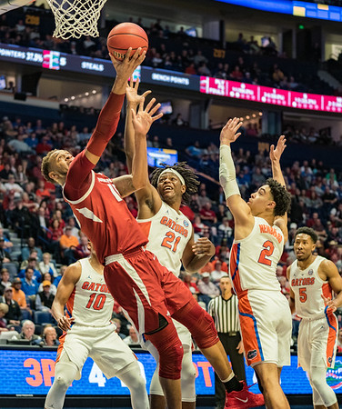 Arkansas Razorbacks forward Daniel Gafford (10) with a reverse layup during an SEC Tournament basketball game between the Arkansas Razorbacks and the Florida Gators on Thursday, March 14, 2019, at Bridgestone Arena.  (Alan Jamison, Nate Allen Sports Service)