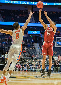 Arkansas Razorbacks guard Jalen Harris (5) shoots over Florida Gators guard KeVaughn Allen (5) during an SEC Tournament basketball game between the Arkansas Razorbacks and the Florida Gators on Thursday, March 14, 2019, at Bridgestone Arena.  (Alan Jamison, Nate Allen Sports Service)