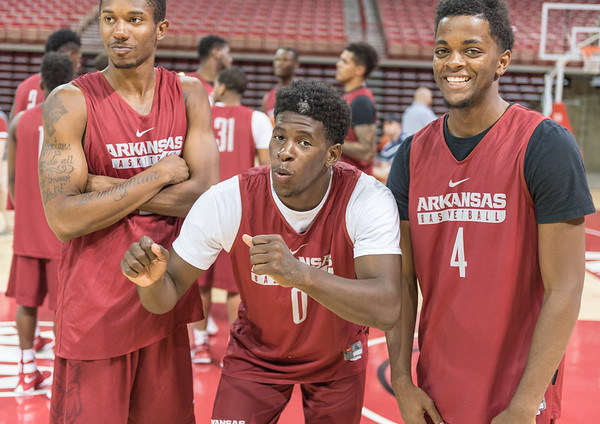 C. J. Jones, Jaylen Barford, and Daryl Macon pose for a photo during the 2016 Arkansas Razorbacks Men's Basketball Media Day and practice on Wednesday, October 5, 2016.  (Alan Jamison, Nate Allen Sports Service)