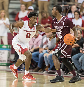 Arkansas Razorbacks guard Jaylen Barford (0) attempts a steal during a basketball game between Arkansas and Mississippi State on Tuesday, January 10, 2017.  (Alan Jamison, Nate Allen Sports Service)