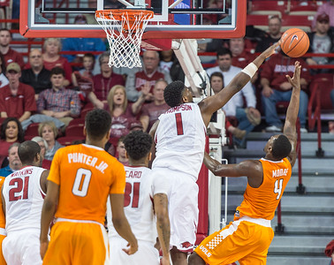 Arkansas Razorbacks forward Trey Thompson (1) defends a shot by Tennessee Volunteers forward Armani Moore (4) during a basketball game between Arkansas Razorbacks and Tennessee Volunteers  on February 6, 2016.    (Alan Jamison, Nate Allen Sports Service)