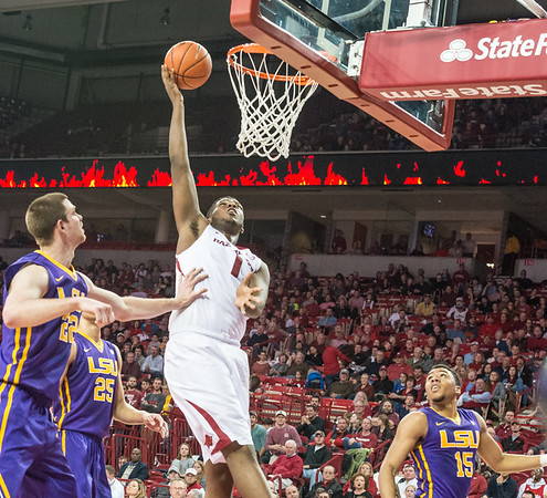 Arkansas Razorbacks forward Trey Thompson (1) goes inside for two against Darcy Malone and Ben Simmons during a basketball game between Arkansas and LSU on 2-23-16.   (Alan Jamison, Nate Allen Sports Service)