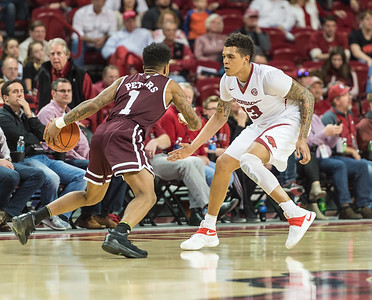 Arkansas Razorbacks forward Dustin Thomas (13) defends against Mississippi State Bulldogs guard Lamar Peters (1)  during a basketball game between Arkansas and Mississippi State on Tuesday, January 10, 2017.  (Alan Jamison, Nate Allen Sports Service)