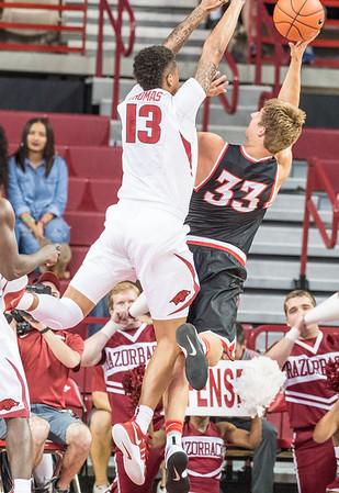 Arkansas Razorbacks forward Dustin Thomas (13) defends during a basketball game between Arkansas and Central Missouri on Friday, October 28, 2016.  (Alan Jamison, Nate Allen Sports Service)