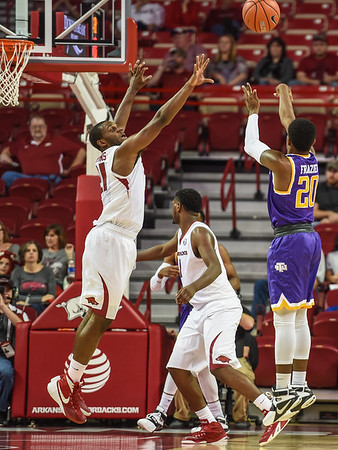 Arkansas Razorbacks guard Manuale Watkins (21) guards Tennessee Tech Golden Eagles guard Savonte Frazier (20) during a basketball game between Arkansas and Tennessee Tech on December 12, 2015.    (Alan Jamison, Nate Allen Sports Service)