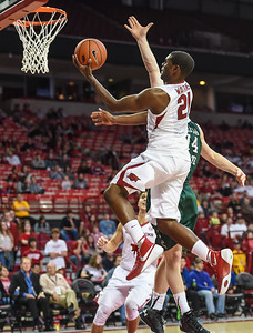 Manuale Watkins with a layup during a basketball game between Arkansas and Delta State on November 10, 2015.    (Alan Jamison, Nate Allen Sports Service)