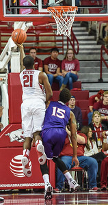 Arkansas Razorbacks guard Manuale Watkins (21) with a layup during a basketball game between Arkansas and Northwestern State on December 1, 2015.    (Alan Jamison, Nate Allen Sports Service)