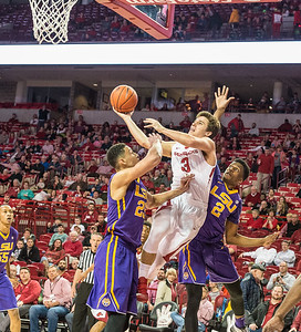 Arkansas Razorbacks guard Dusty Hannahs (3) goes up for two over LSU Tigers forward Ben Simmons (25) during a basketball game between Arkansas and LSU on 2-23-16.   (Alan Jamison, Nate Allen Sports Service)