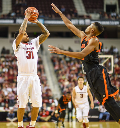Arkansas Razorbacks guard Anton Beard (31) shoots during a basketball game between Arkansas and Mercer on December 19, 2015.    (Alan Jamison, Nate Allen Sports Service)