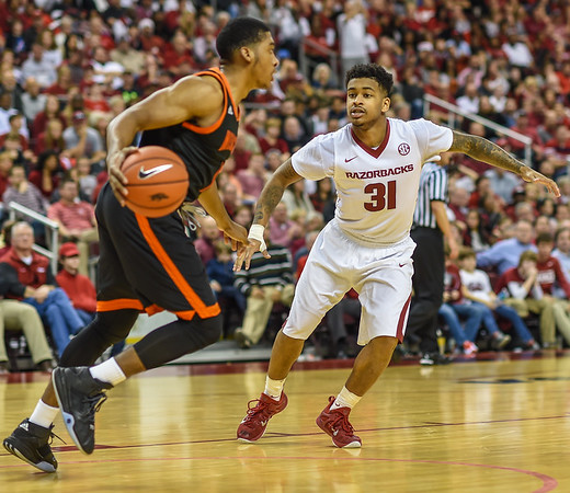 Arkansas Razorbacks guard Anton Beard (31) on defense during a basketball game between Arkansas and Mercer on December 19, 2015.    (Alan Jamison, Nate Allen Sports Service)