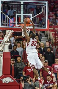Arkansas Razorbacks forward Moses Kingsley (33) with a two-handed dunk during a basketball game between Arkansas and Southern University on November 13, 2015.    (Alan Jamison, Nate Allen Sports Service)