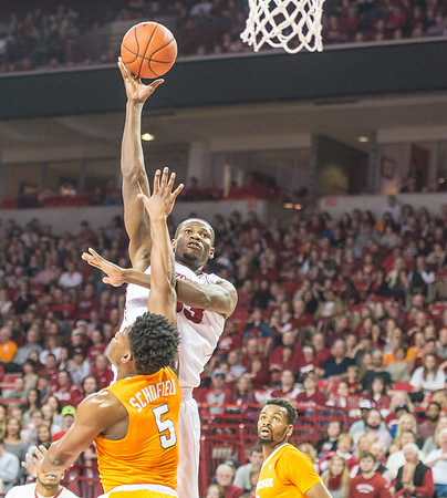 Arkansas Razorbacks forward Moses Kingsley (33) shoots over Tennessee Volunteers forward Admiral Schofield (5) during a basketball game between Arkansas Razorbacks and Tennessee Volunteers  on February 6, 2016.    (Alan Jamison, Nate Allen Sports Service)