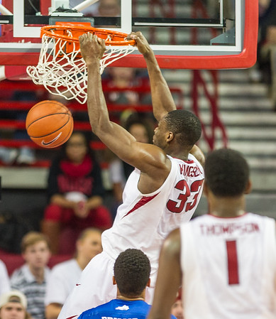 Arkansas Razorbacks forward Moses Kingsley (33) with a dunk during a basketball game between Arkansas Razorbacks and Kentucky Wildcats on January 21, 2016.    (Alan Jamison, Nate Allen Sports Service)