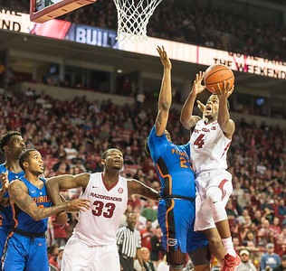 Arkansas Razorbacks guard Daryl Macon (4) goes up for two during a basketball game between Arkansas and Florida on Thursday, December 29, 2016.  (Alan Jamison, Nate Allen Sports Service)