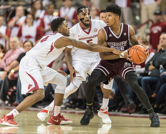 Arkansas Razorbacks guard Daryl Macon (4) and forward Arlando Cook (5) trap a Mississippi State player during a basketball game between Arkansas and Mississippi State on Tuesday, January 10, 2017.  (Alan Jamison, Nate Allen Sports Service)