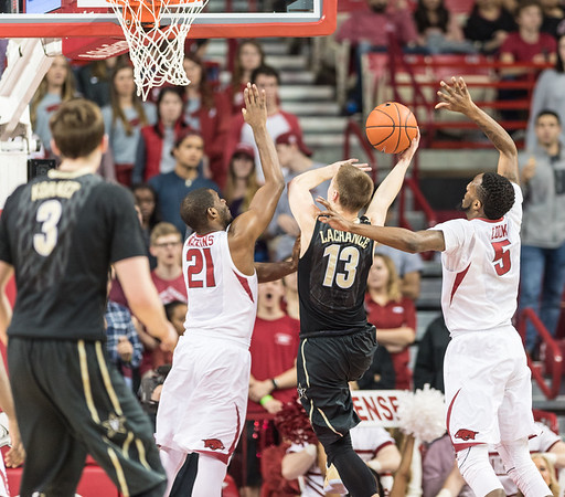 Vanderbilt Commodores guard Riley LaChance (13) goes up for a shot against Arkansas Razorbacks guard Manuale Watkins (21) and Arkansas Razorbacks forward Arlando Cook (5) during a basketball game between Arkansas and Vanderbilt on Tuesday, February 7, 2017.  (Alan Jamison, Nate Allen Sports Service)