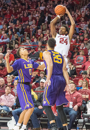 Arkansas Razorbacks guard Jimmy Whitt (24) shoots a three point basket over Ben Simmons and Brandon Sampson during a basketball game between Arkansas and LSU on 2-23-16.   (Alan Jamison, Nate Allen Sports Service)
