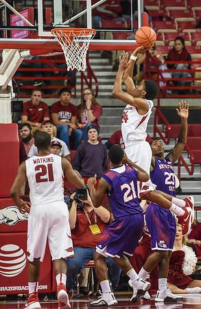 Arkansas Razorbacks guard Jimmy Whitt (24) with a shot during a basketball game between Arkansas and Northwestern State on December 1, 2015.    (Alan Jamison, Nate Allen Sports Service)
