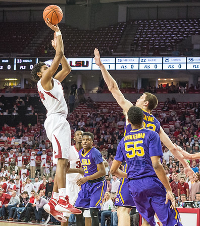 Arkansas Razorbacks guard Jimmy Whitt (24) shoots a jump shot over LSU Tigers center Darcy Malone (22) during a basketball game between Arkansas and LSU on 2-23-16.   (Alan Jamison, Nate Allen Sports Service)