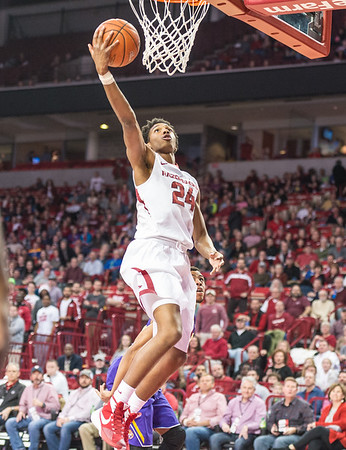 Arkansas Razorbacks guard Jimmy Whitt (24) with a layup during a basketball game between Arkansas and LSU on 2-23-16.   (Alan Jamison, Nate Allen Sports Service)