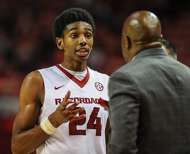 Arkansas Razorbacks guard Jimmy Whitt (24) talks to Arkansas head coach Mike Anderson in a timeout  during a basketball game between Arkansas and Tennessee Tech on December 12, 2015.    (Alan Jamison, Nate Allen Sports Service)