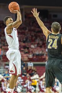 Arkansas Razorbacks guard Anthlon Bell (5) shoots during a basketball game between Arkansas and Vanderbilt on January 5, 2016.    (Alan Jamison, Nate Allen Sports Service)