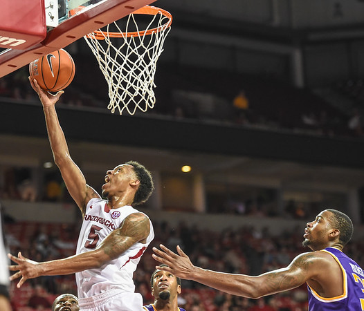 Arkansas Razorbacks guard Anthlon Bell (5) with a reverse layup  during a basketball game between Arkansas and Tennessee Tech on December 12, 2015.    (Alan Jamison, Nate Allen Sports Service)