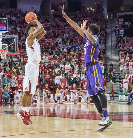 Arkansas Razorbacks guard Anthlon Bell (5) shoots a three point basket during a basketball game between Arkansas and LSU on 2-23-16.   (Alan Jamison, Nate Allen Sports Service)