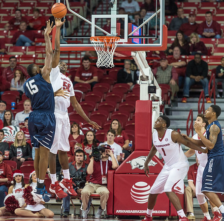 Arkansas Razorbacks center Willy Kouassi (50) with a block against North Florida Ospreys center Ismaila Dauda (15) during a basketball game between Arkansas and North Florida on December 22, 2015.    (Alan Jamison, Nate Allen Sports Service)