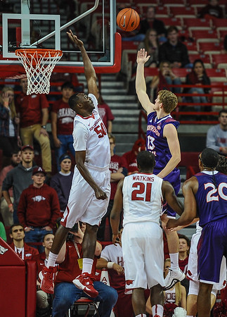 Arkansas Razorbacks center Willy Kouassi (50) defends a shot by Northwestern State Demons forward Matt Killian (13) during a basketball game between Arkansas and Northwestern State on December 1, 2015.    (Alan Jamison, Nate Allen Sports Service)