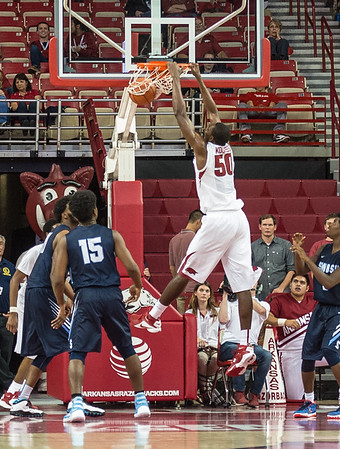 Arkansas Razorbacks center Willy Kouassi (50) with a stuff during a basketball game between the Arkansas Razorbacks and the Southwestern Oklahoma State Bulldogs in Bud Walton Arena on November 5, 2015.   Arkansas won 103-58.   (Alan Jamison, Nate Allen Sports Service)