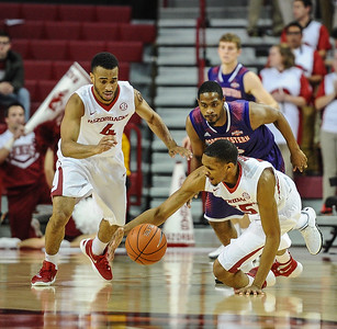 Arkansas Razorbacks forward Keaton Miles (55) dives for a loose ball during a basketball game between Arkansas and Northwestern State on December 1, 2015.    (Alan Jamison, Nate Allen Sports Service)