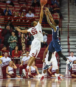 Arkansas Razorbacks forward Keaton Miles (55) with a block during a basketball game between Arkansas and Akron on November 18, 2015.    (Alan Jamison, Nate Allen Sports Service)