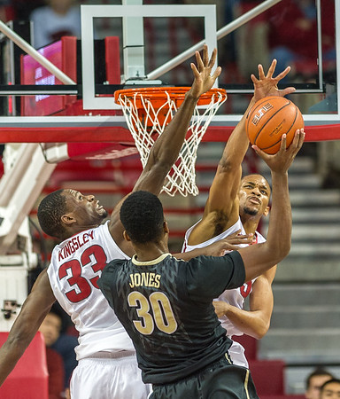 Arkansas Razorbacks forward Keaton Miles (55) gets a block as he and Arkansas Razorbacks forward Moses Kingsley (33) defend against Vanderbilt Commodores center Damian Jones (30) during a basketball game between Arkansas and Vanderbilt on January 5, 2016.    (Alan Jamison, Nate Allen Sports Service)