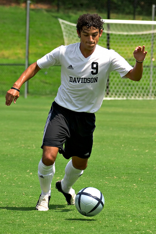 davidson college versus unc-w men's soccer ncaa sports photos