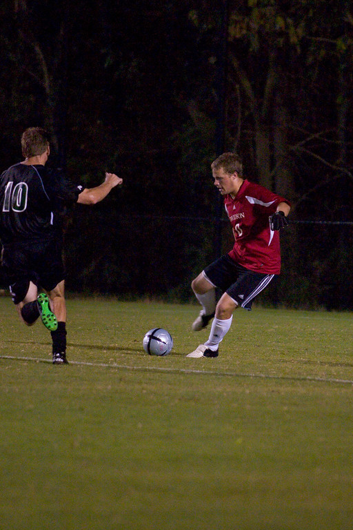 Number 10 gets taken to school in footwork by the...GOALIE! davidson college versus unc-c men's soccer ncaa sports photos