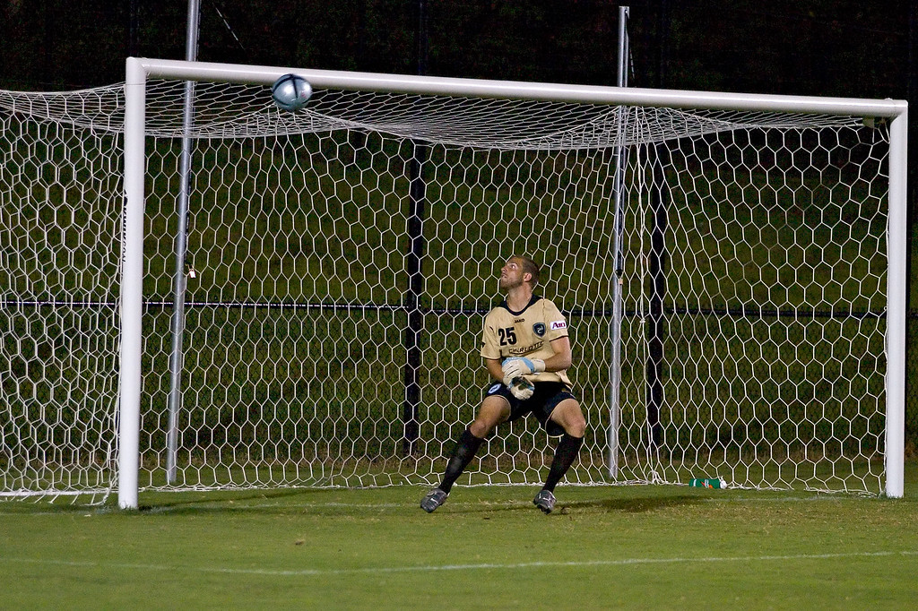 """Duuuuuh, look at the pretty bally going into the net"" davidson college versus unc-c men's soccer ncaa sports photos"