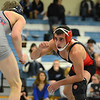 RYAN HUTTON/ Staff photo.<br /> North Andover's Zane Melillo, right, sizes up Mt. Anthony's Dylan La Fountain in the 132 pound finals of the Methuen Invitational wrestling meet. Melillo defeated La Fountain.