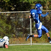 CARL RUSSO/Staff photo. Dracut defender is unable to stop Methuen's Brian Cole from scoring after catching this 57-yard touchdown pass down the sideline seconds before the half to give Methuen the 22-14 lead. Methuen defeated Dracut in Saturday afternoon football action 35-20. 9/28/2013.